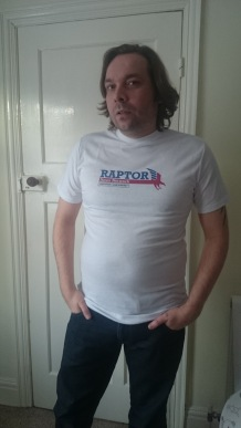 Me wearing the DmC Raptor News Network Tee Note how tight the fit is.